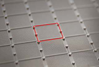 Fluidic layout of a CONSTELLATION® Digital PCR Plate. Each square of microchambers is connected to one well of the 96-well microplate.